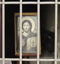 Jesus behind bars