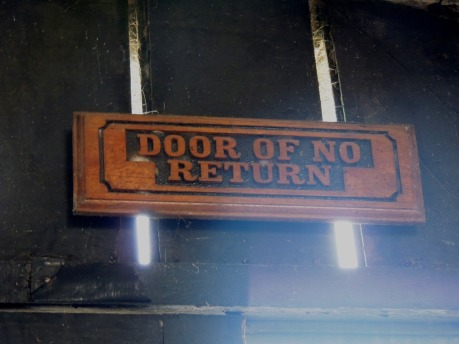 Castle door of no return sign